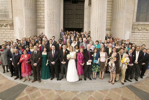 Bride, groom, family & friends on the steps of St Paul's